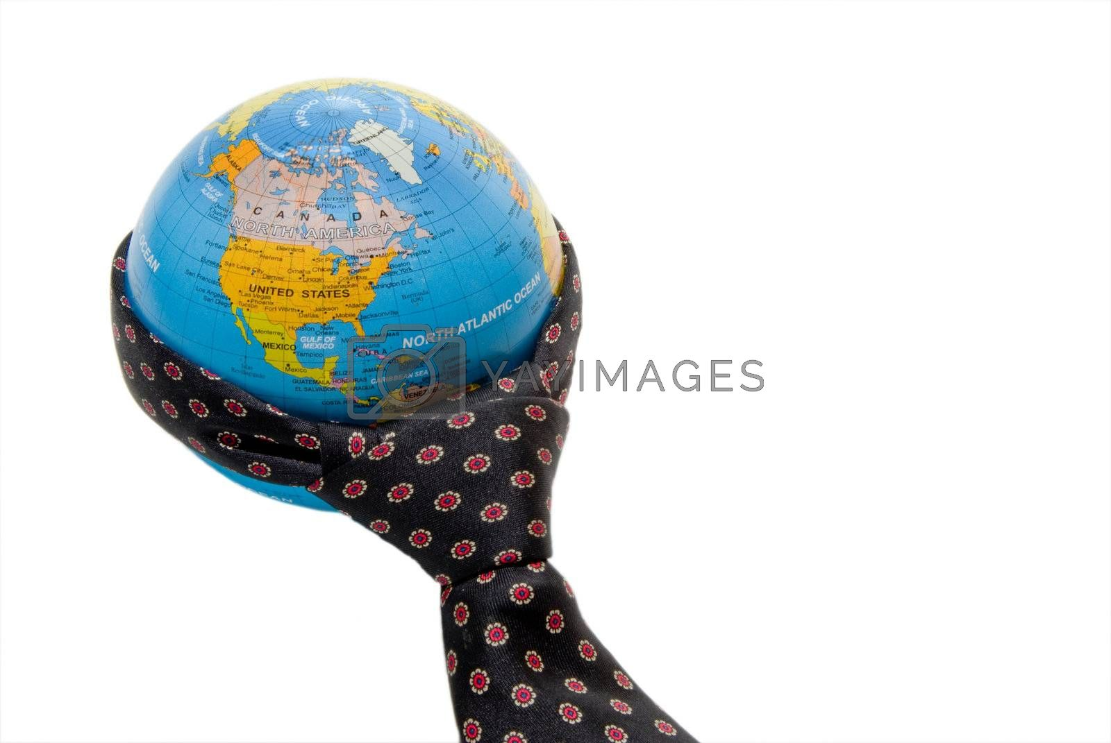 A necktie wrapped aroung a globe of the world.