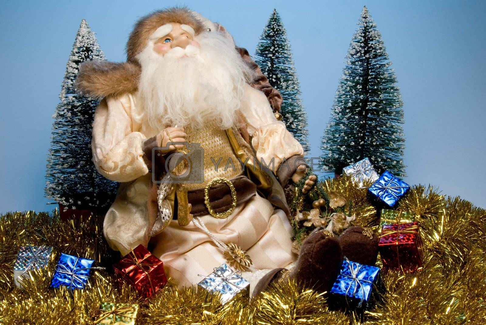 Santa Claus surounded by holiday Christmas gifts.