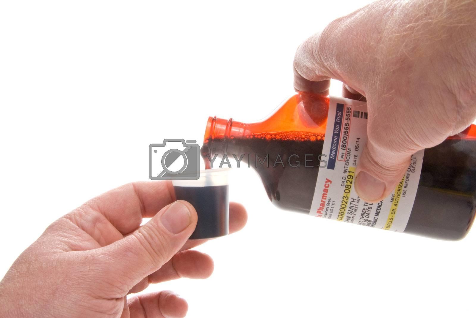 Liquid prescription cough medication in a cup.