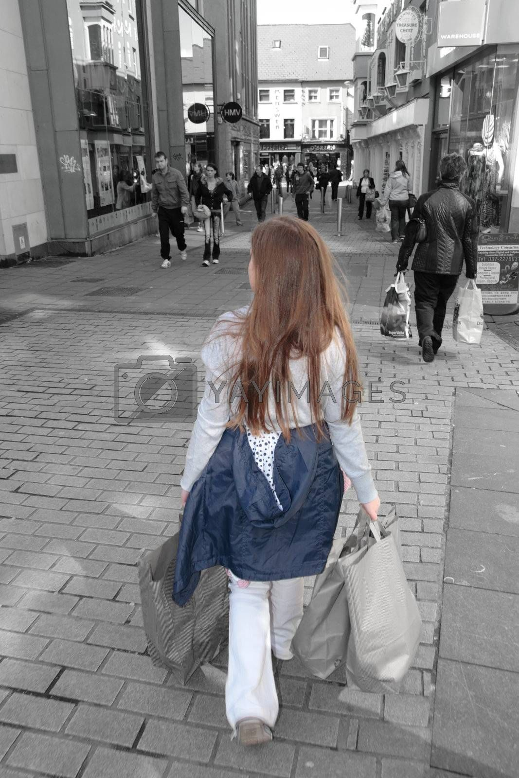 a young girl with shopping bags on a high street