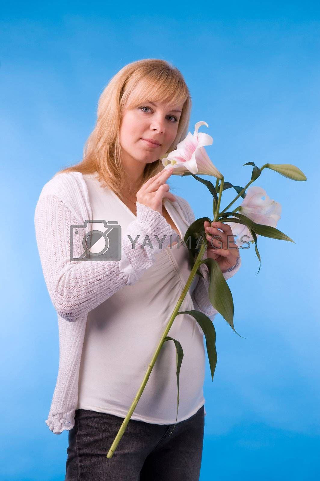 The fine pregnant woman with a bouquet of flowers in hands