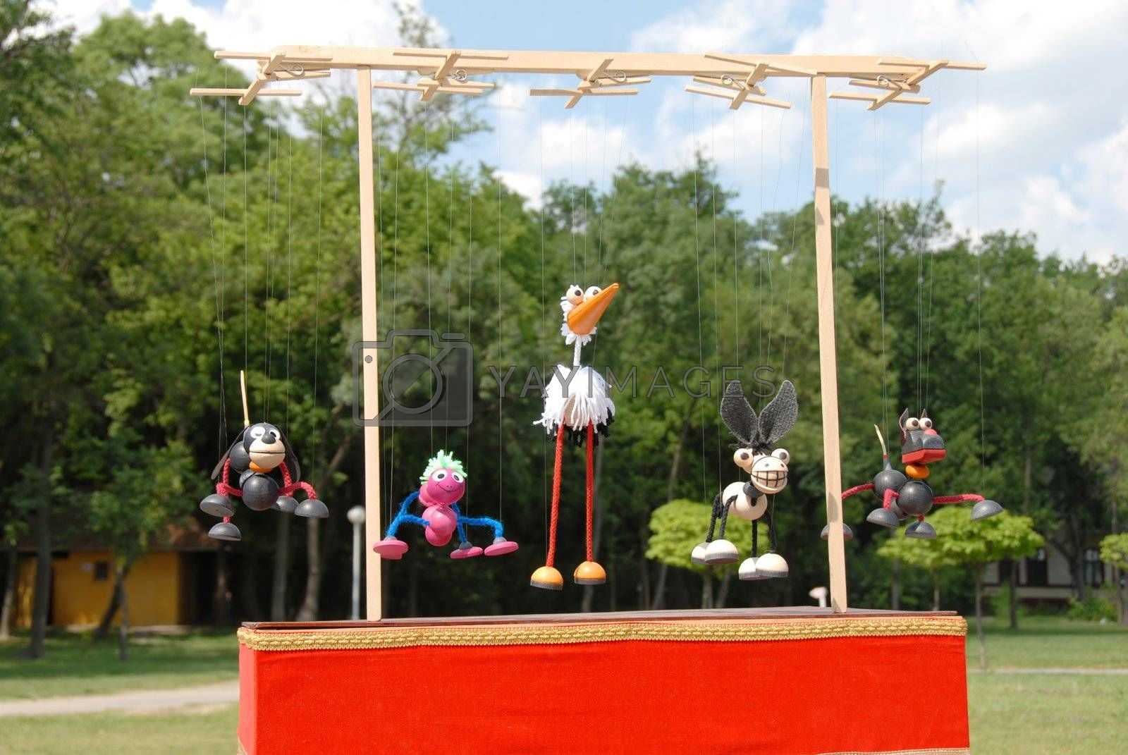 puppets animals hanging on wooden slat outdoor