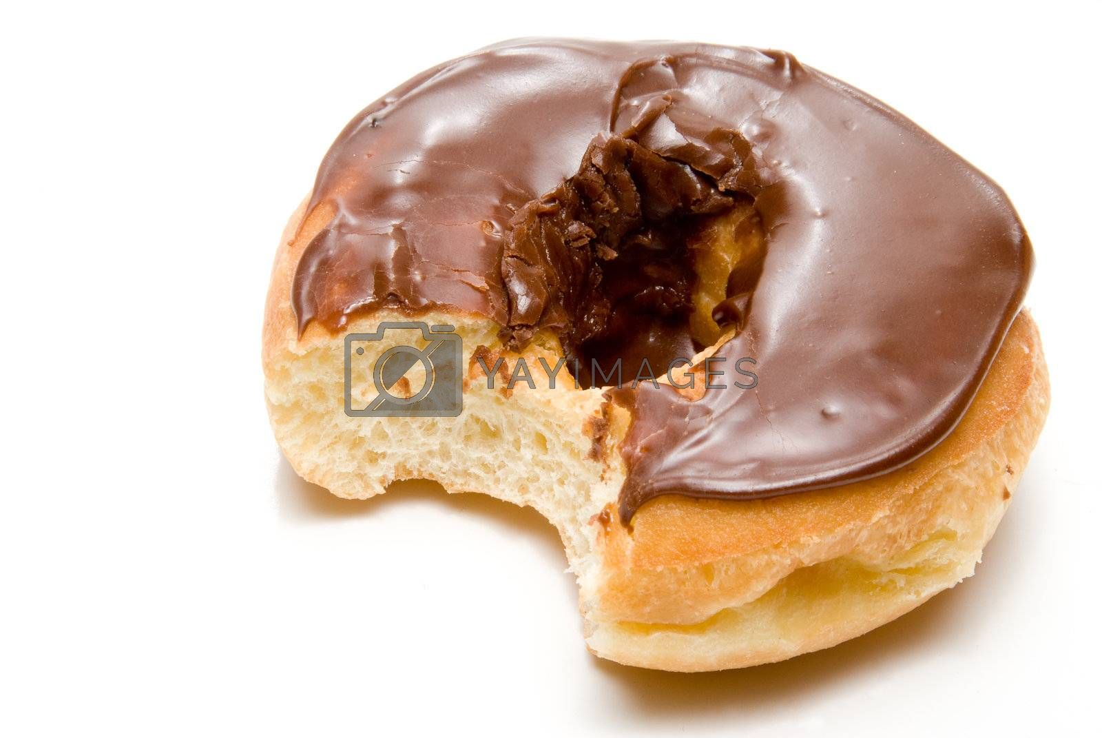 A delicious chocolate covered doughnut ready to be eaten.