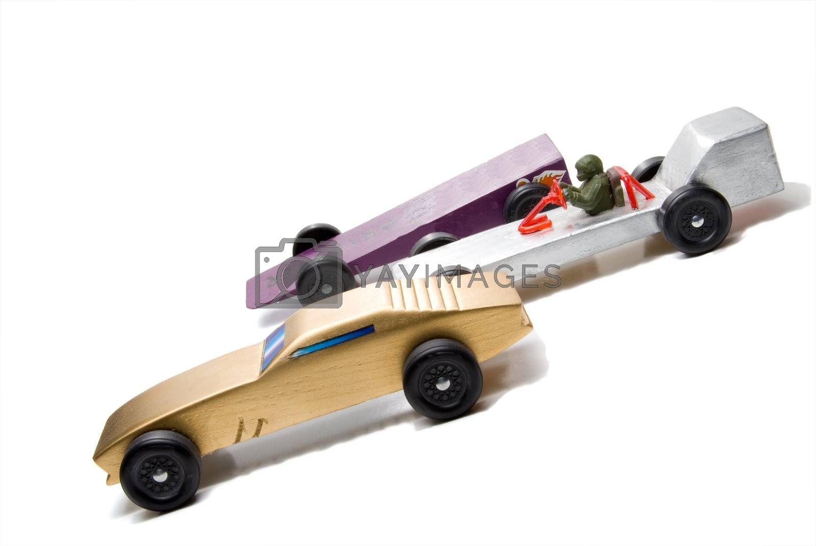 Wooden cars of the type typically used for the Pinewood Derby.