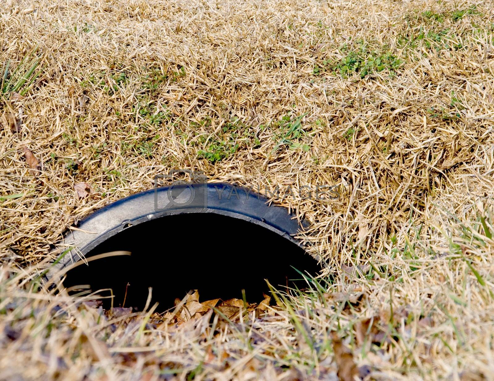 A drainage pipe in a roadside ditch.