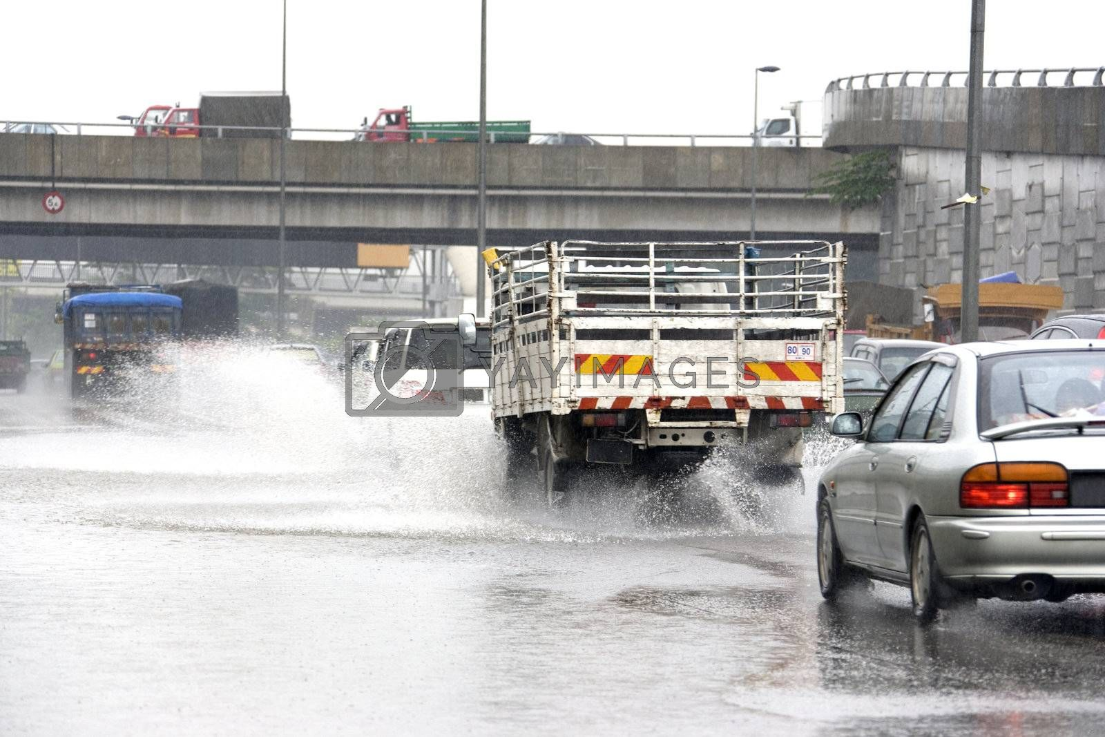 Royalty free image of Traffic in Torrential Rain by shariffc