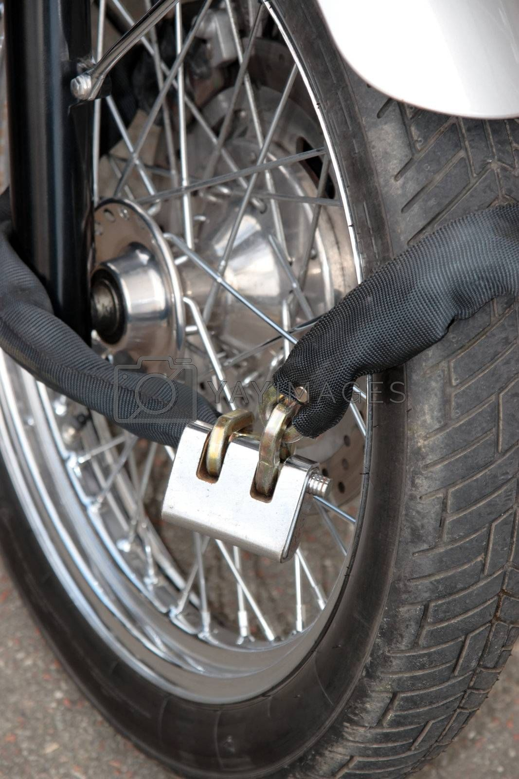 Royalty free image of secure motorbike wheel by morrbyte