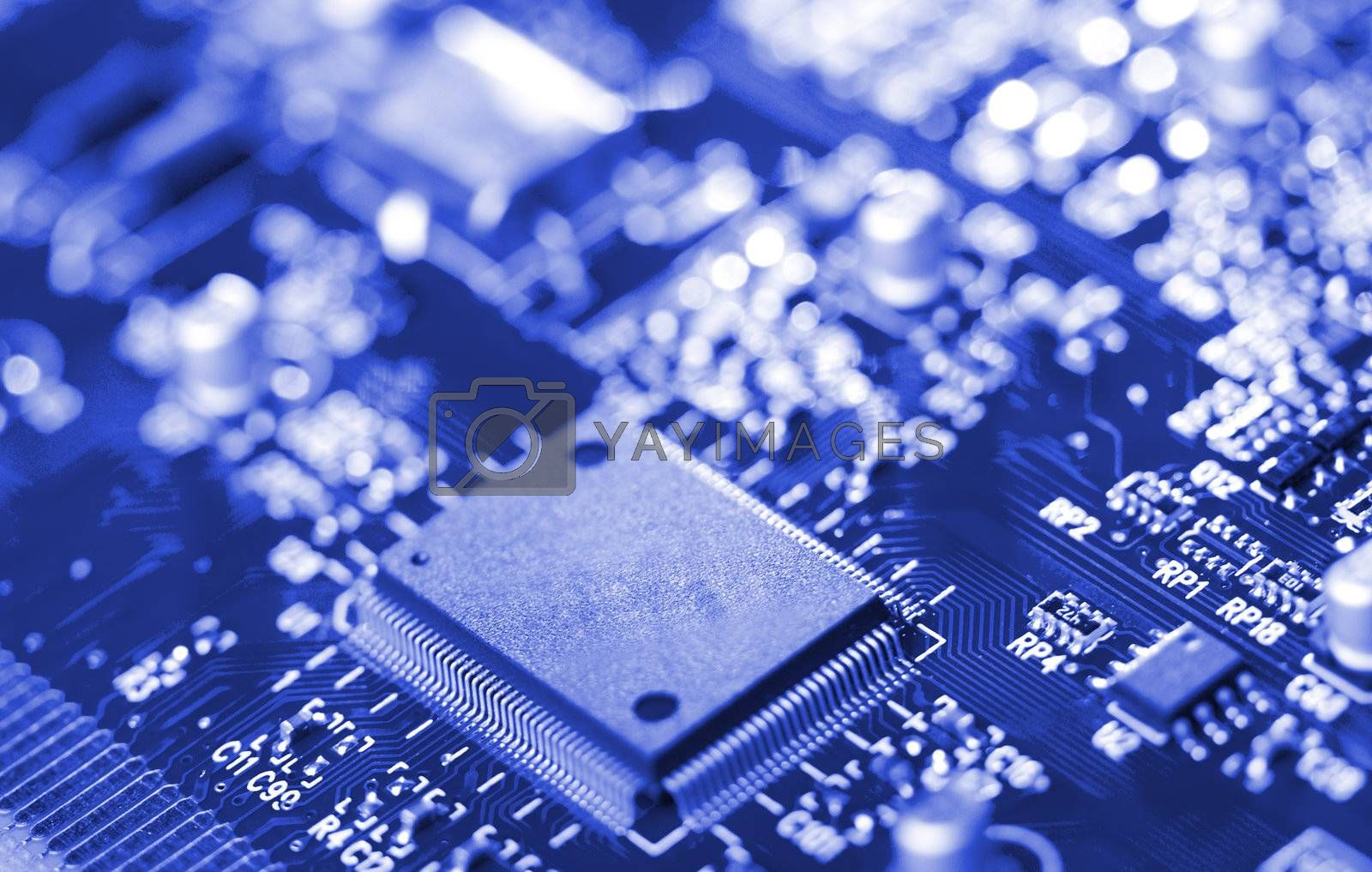Royalty free image of close-up microchip on circuit board by Alekcey