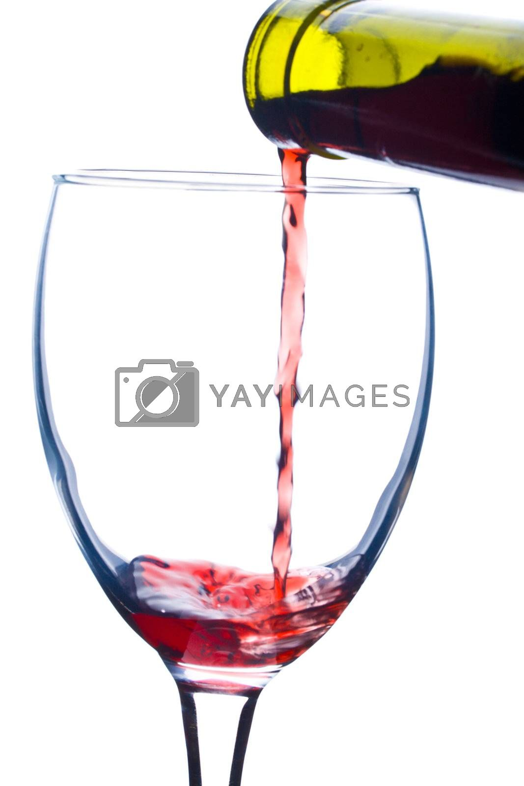 Royalty free image of close-up pouring a wine in glass by Alekcey