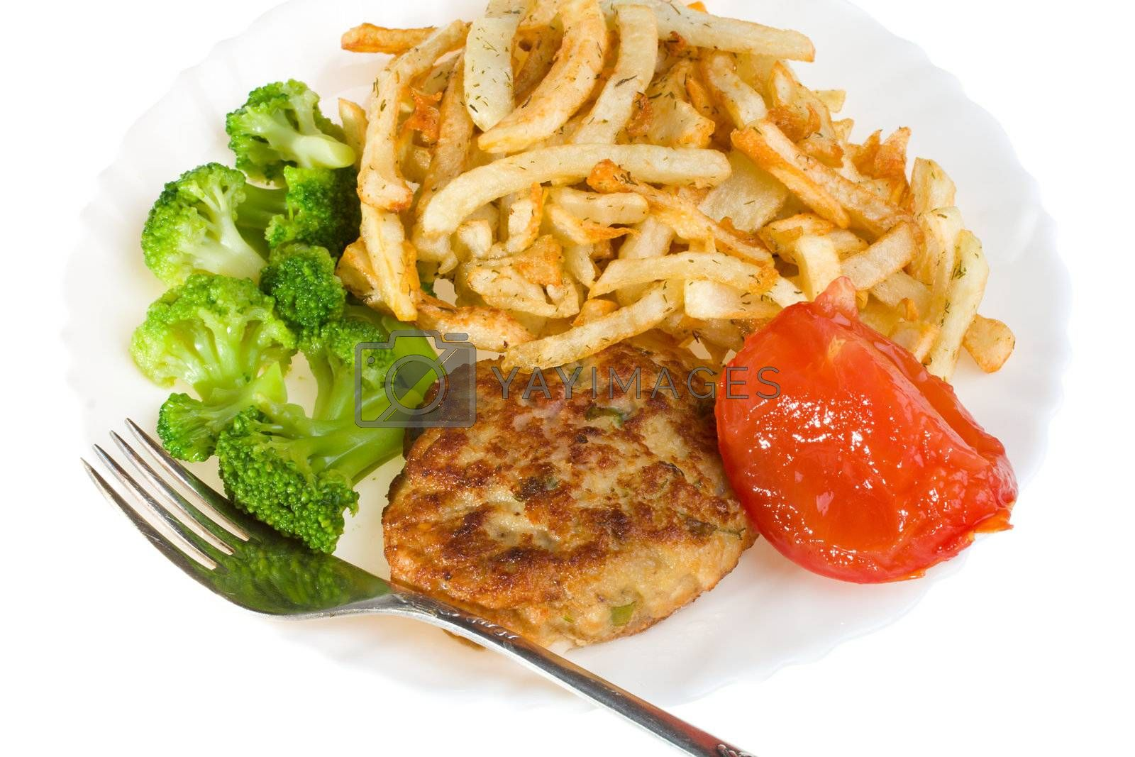 Royalty free image of cutlet with tomato broccoli and potatoes by Alekcey