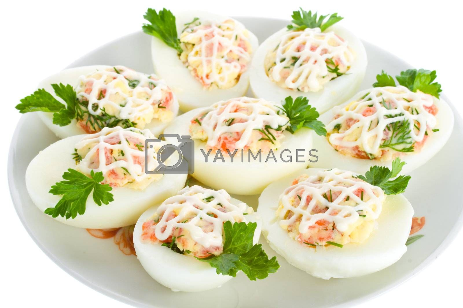close-up eggs stuffed with red fish, view from above, isolated on white