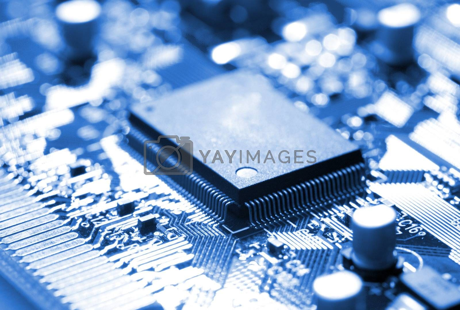 close-up microchip on circuit board, blue toning