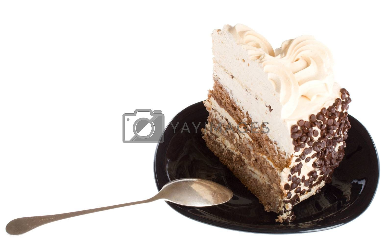 Royalty free image of piece of cake and spoon on black plate by Alekcey