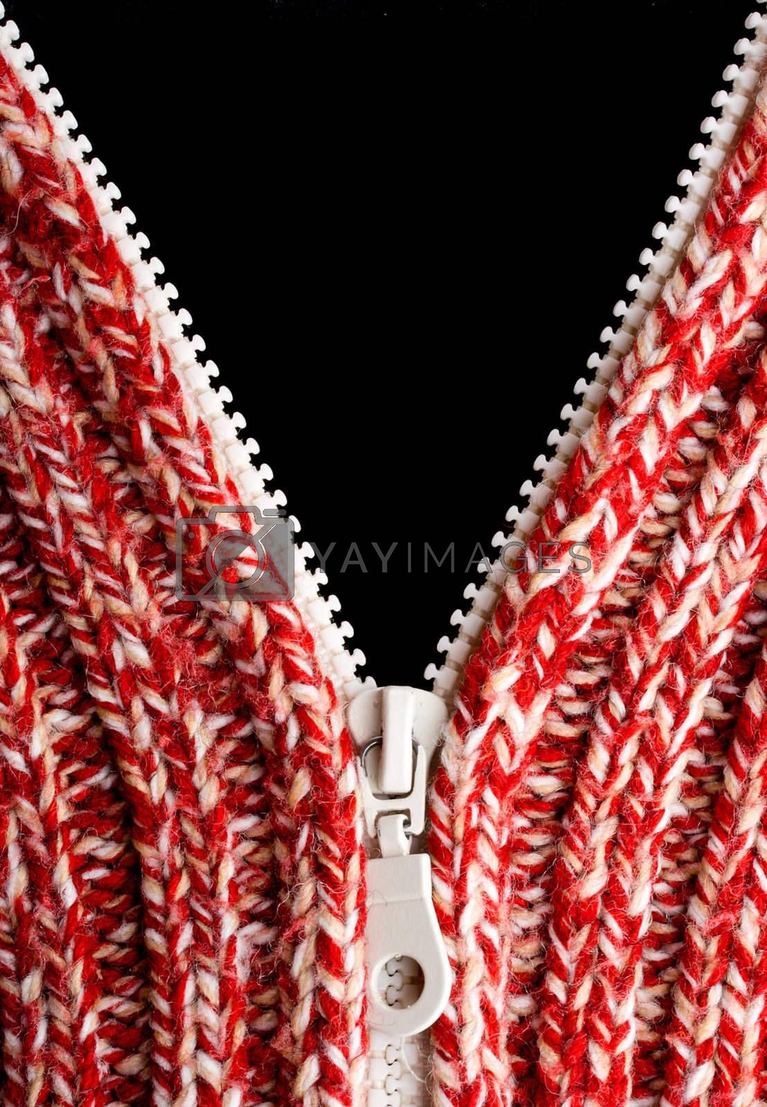 close-up red wool sweater texture with opened zipper and blank black place
