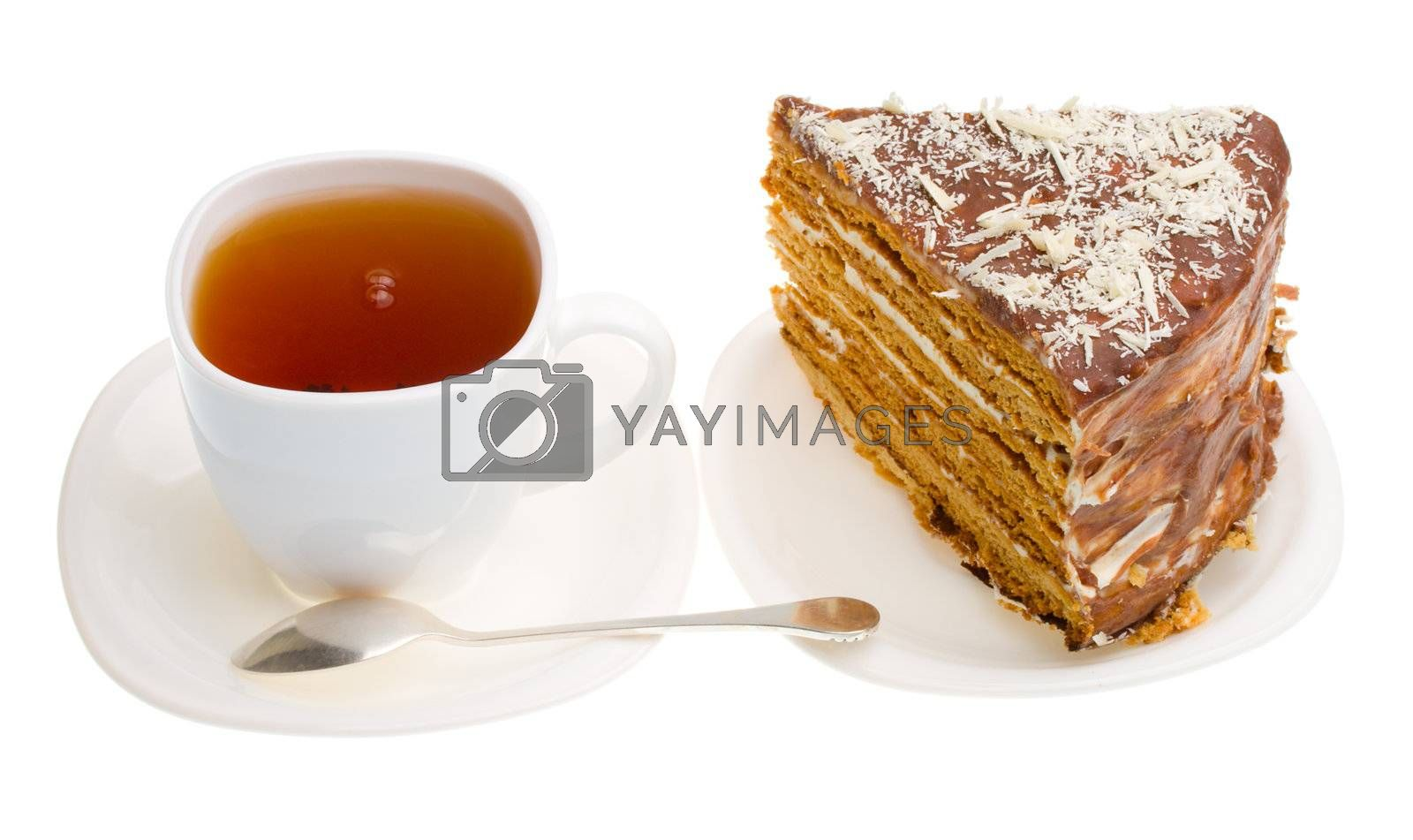 tea cup and piece of home made honey cake, isolated on white