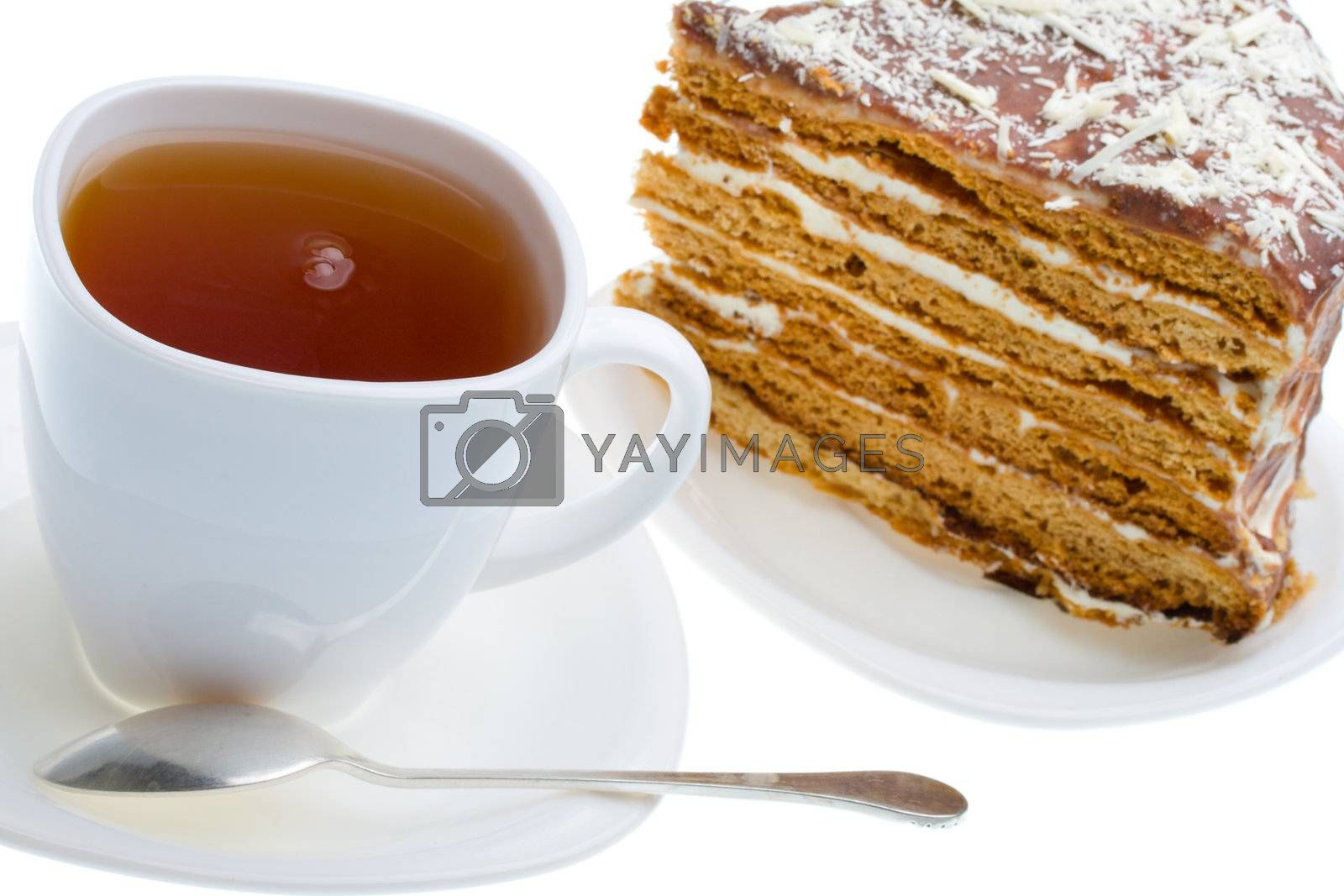 tea cup and piece of honey cake, isolated on white