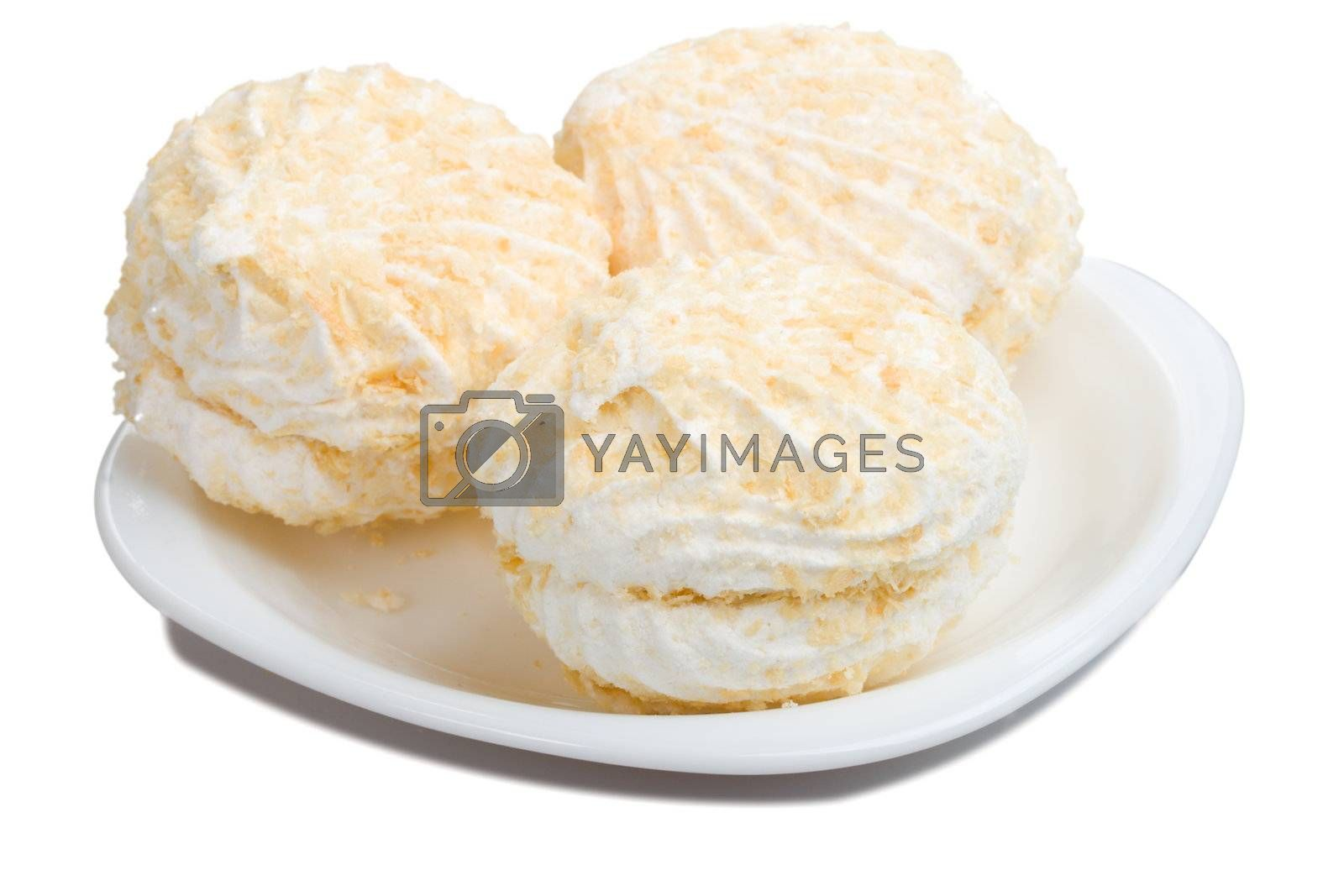 Royalty free image of three marshmallow on plate by Alekcey