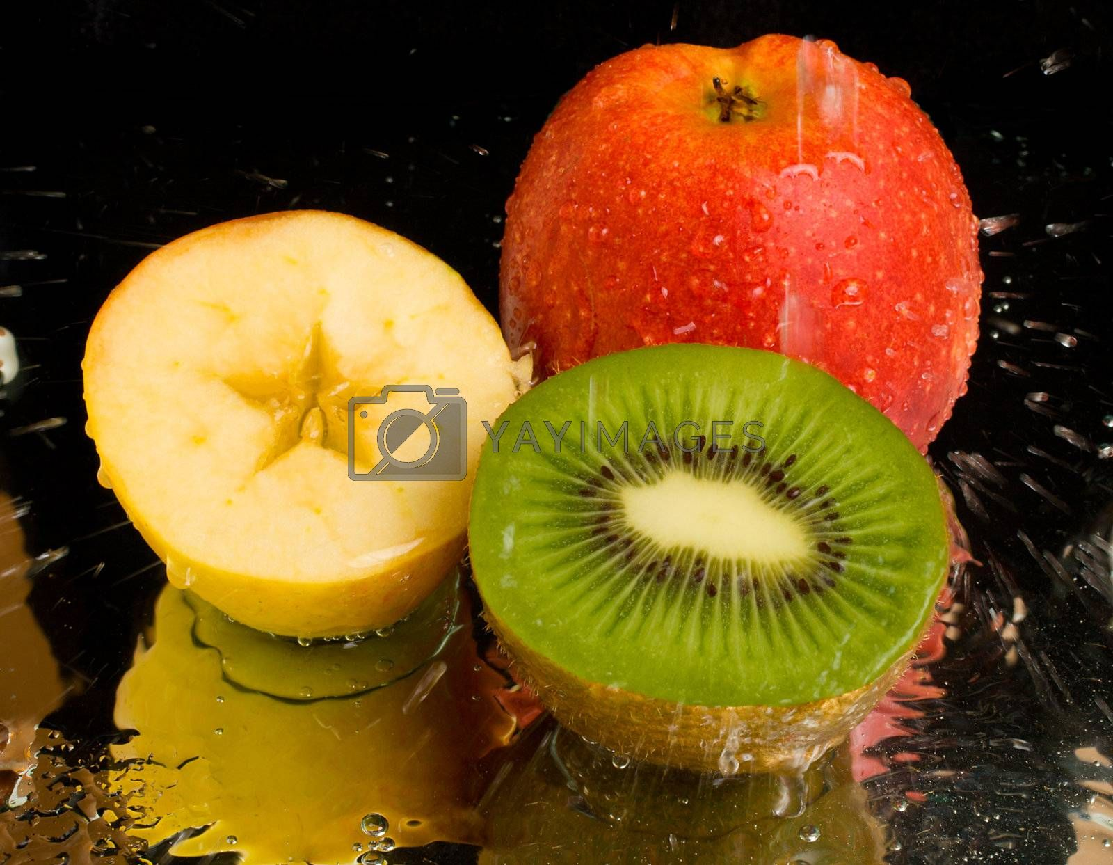 Royalty free image of water spray on kiwi and apples by Alekcey