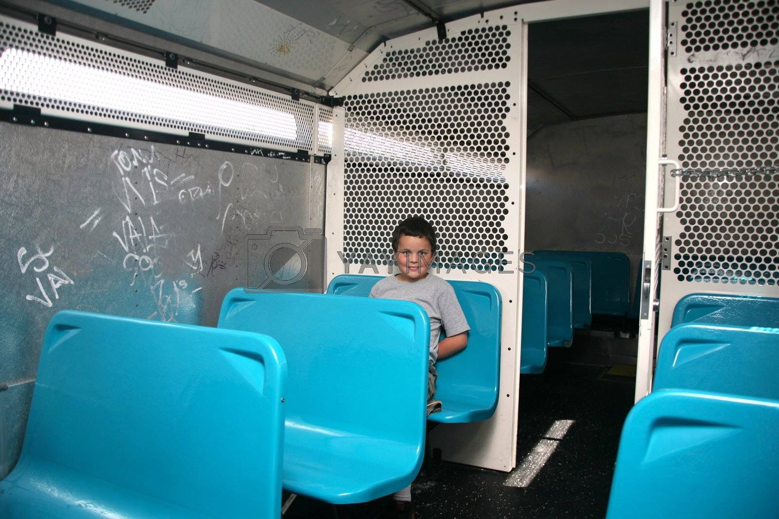 Juvenile delinquent in the police transportation bus