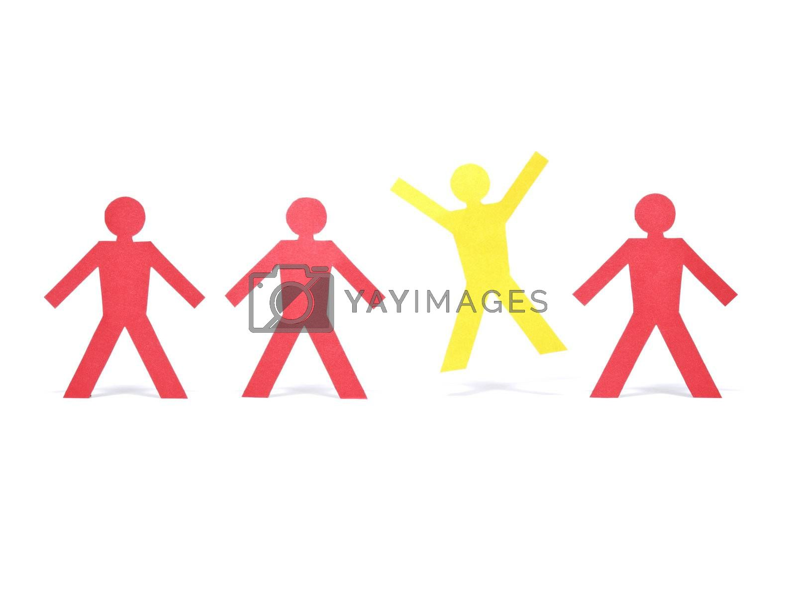 A yellow paper figure is celebrating between other red paper figures.