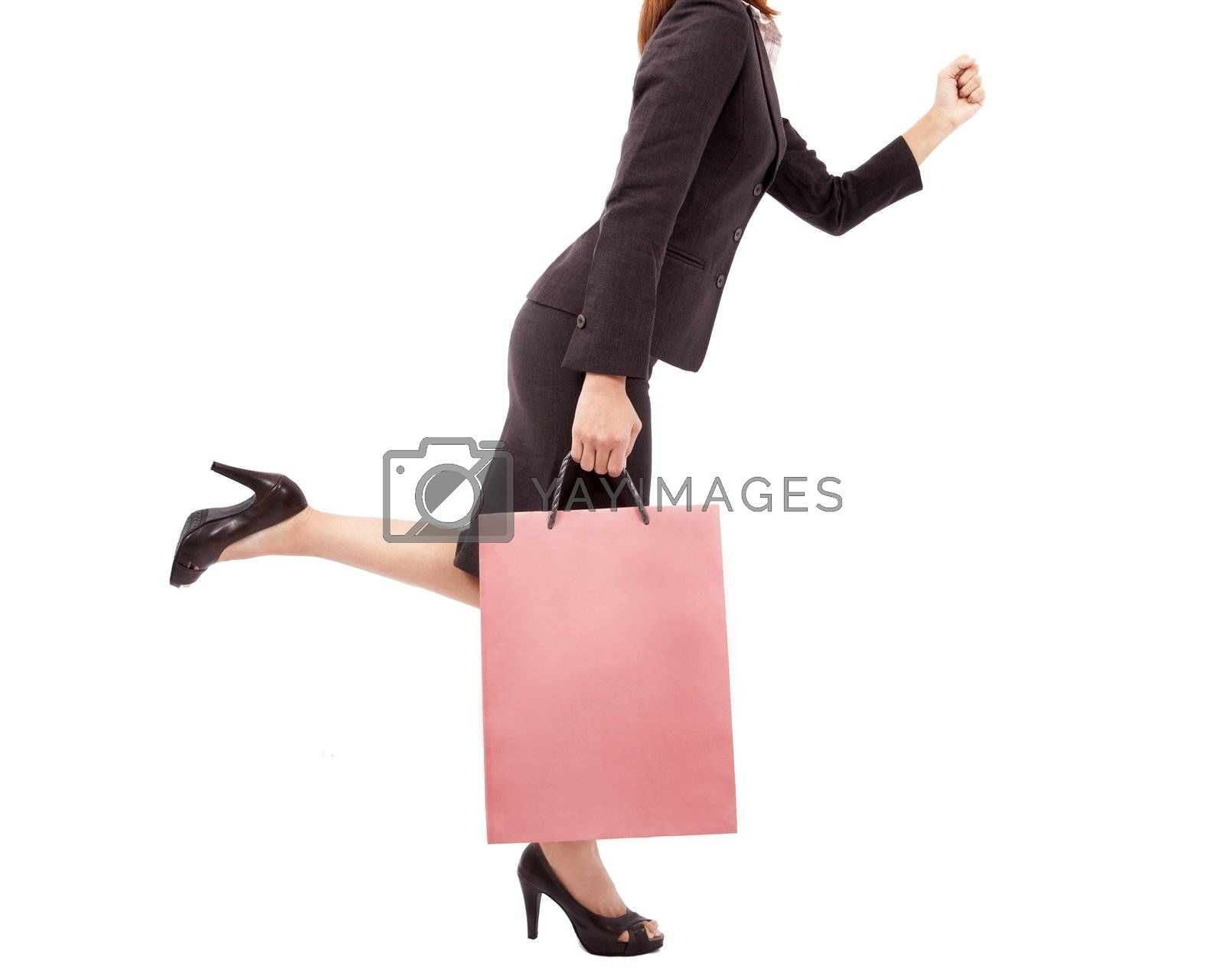 Beautiful and sexy shopping woman with pink shopping bag by tomwang