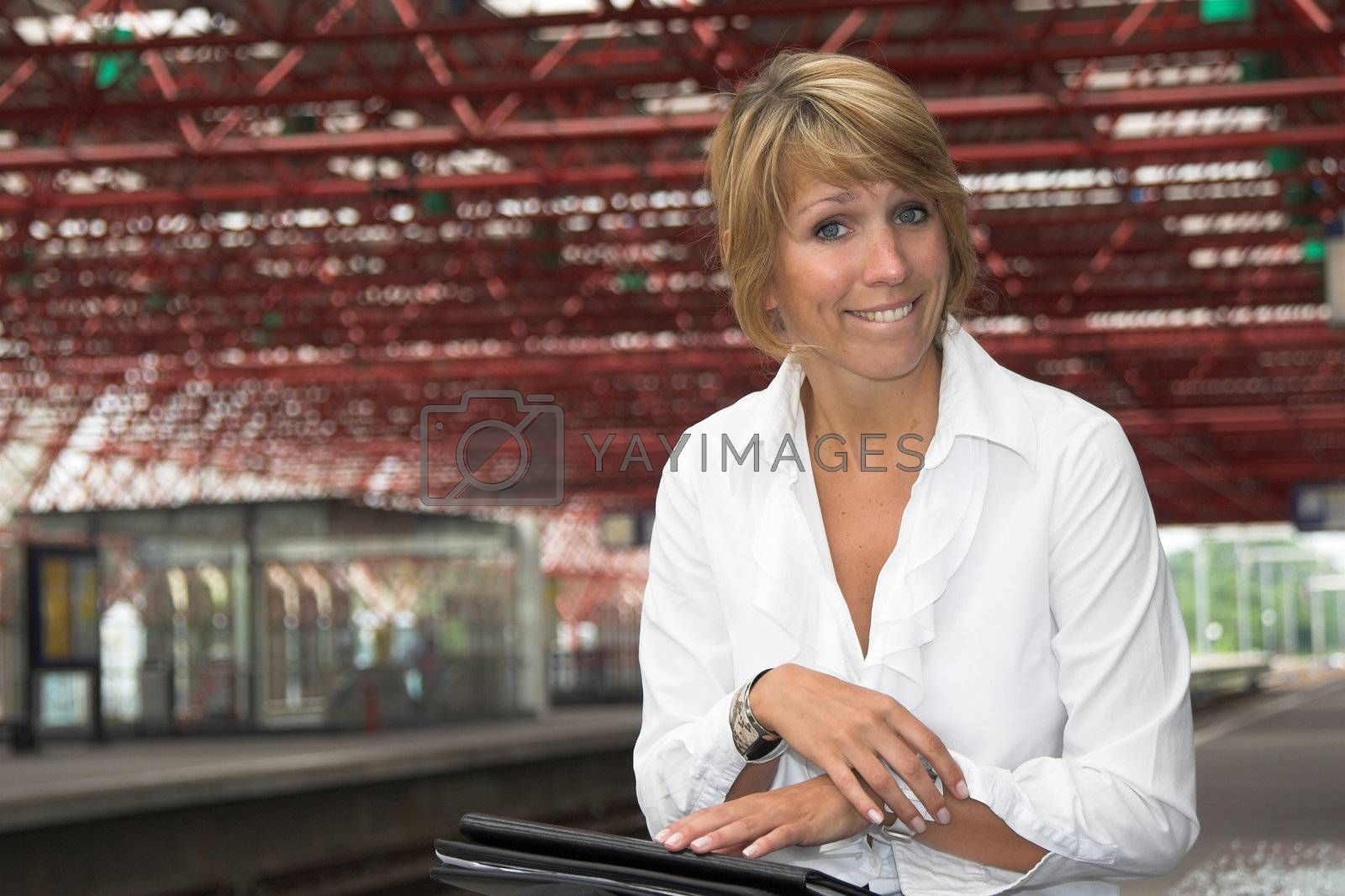 Businesswoman pulling a funny face while waiting for the train