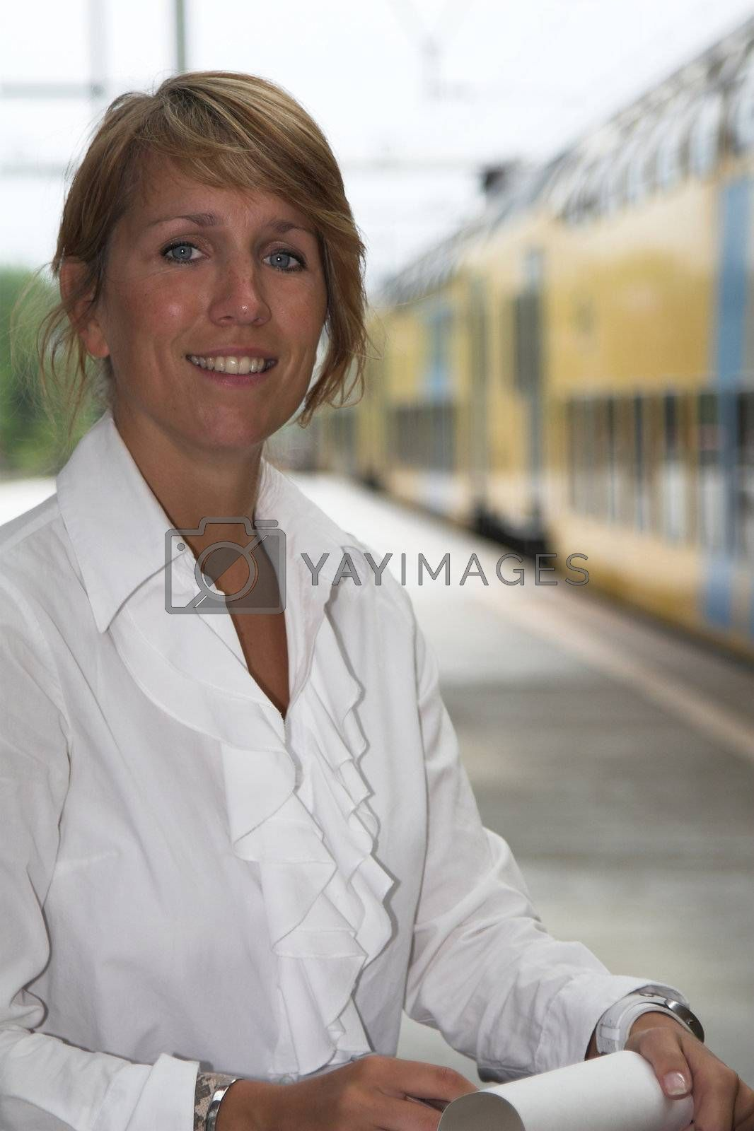 Pretty businesswoman waiting for the train to arrive