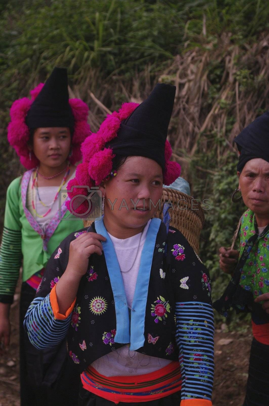 Headdress typical of young Hmong girls red pompoms unmarried. Woman Pha Din Pass
