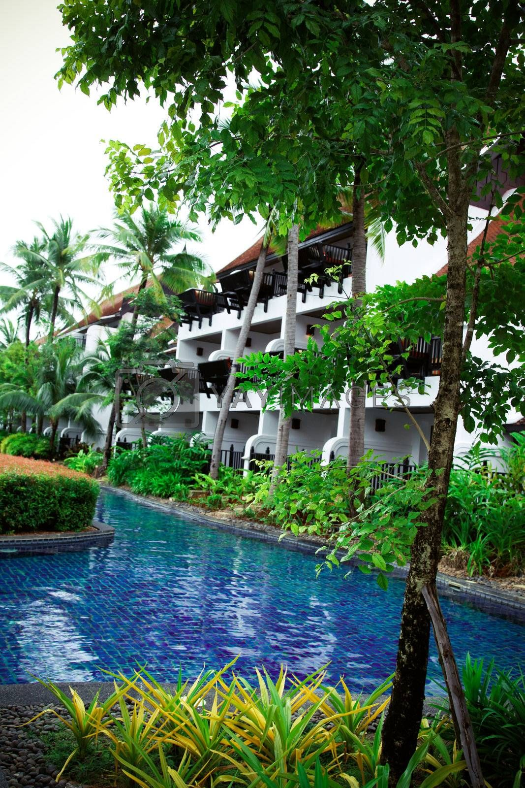 Swimming pool area at a tropical resort in Thailand - travel and tourism.