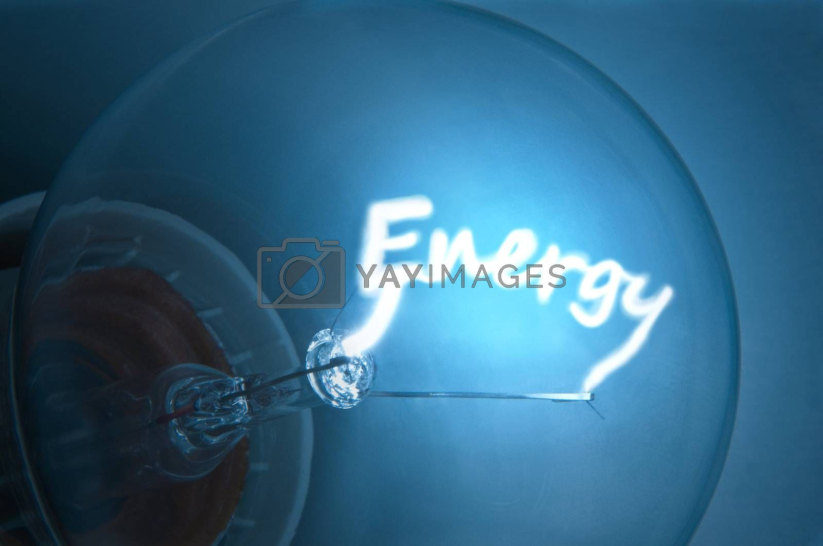 """Close up on illuminated blue light bulb filament which spells the word """"Energy""""."""