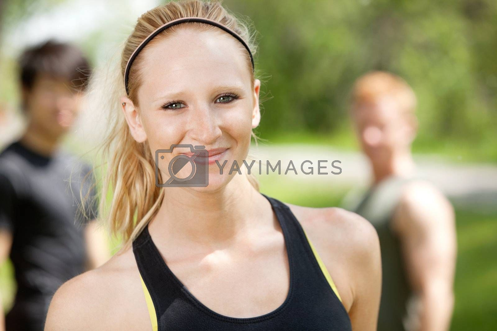 Portrait of attractive woman with friends in background