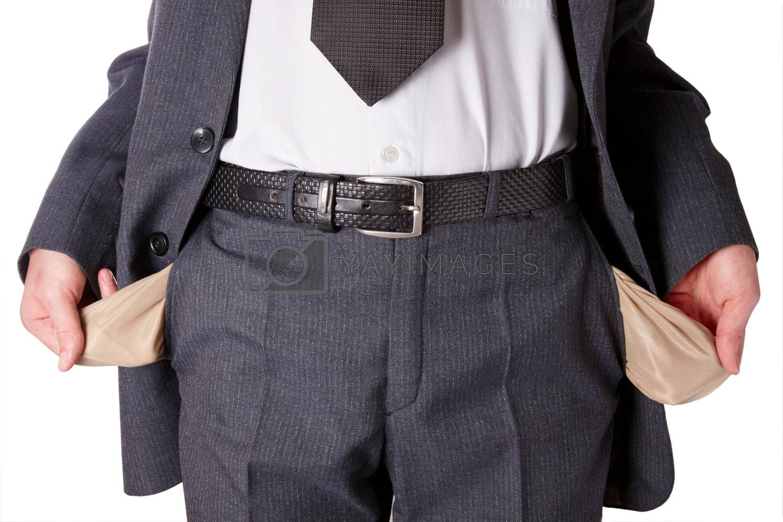 Businessman wearing a tie and showing empty pockets isolated on a white background