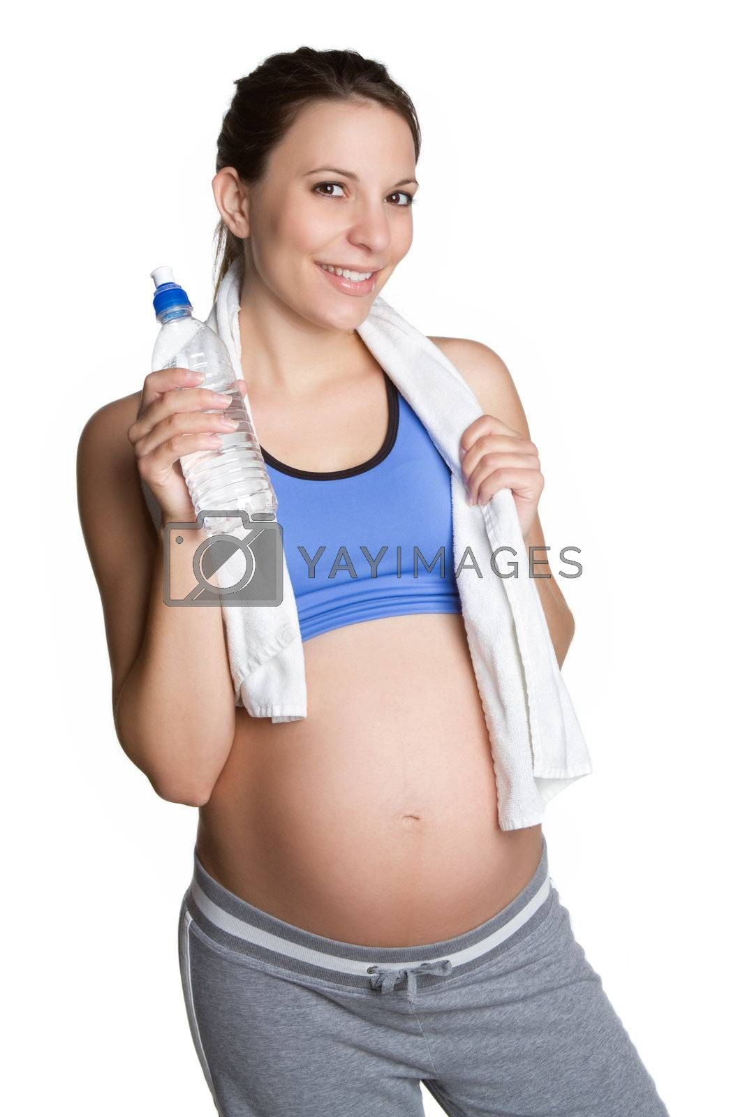 Pregnant fitness woman drinking water