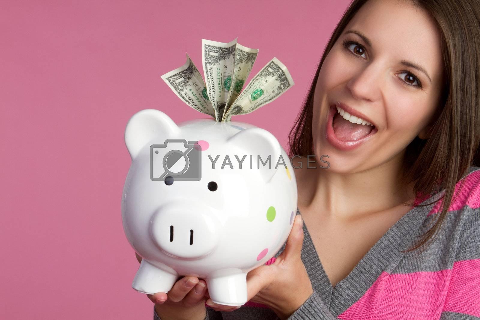 Girl holding piggy bank money