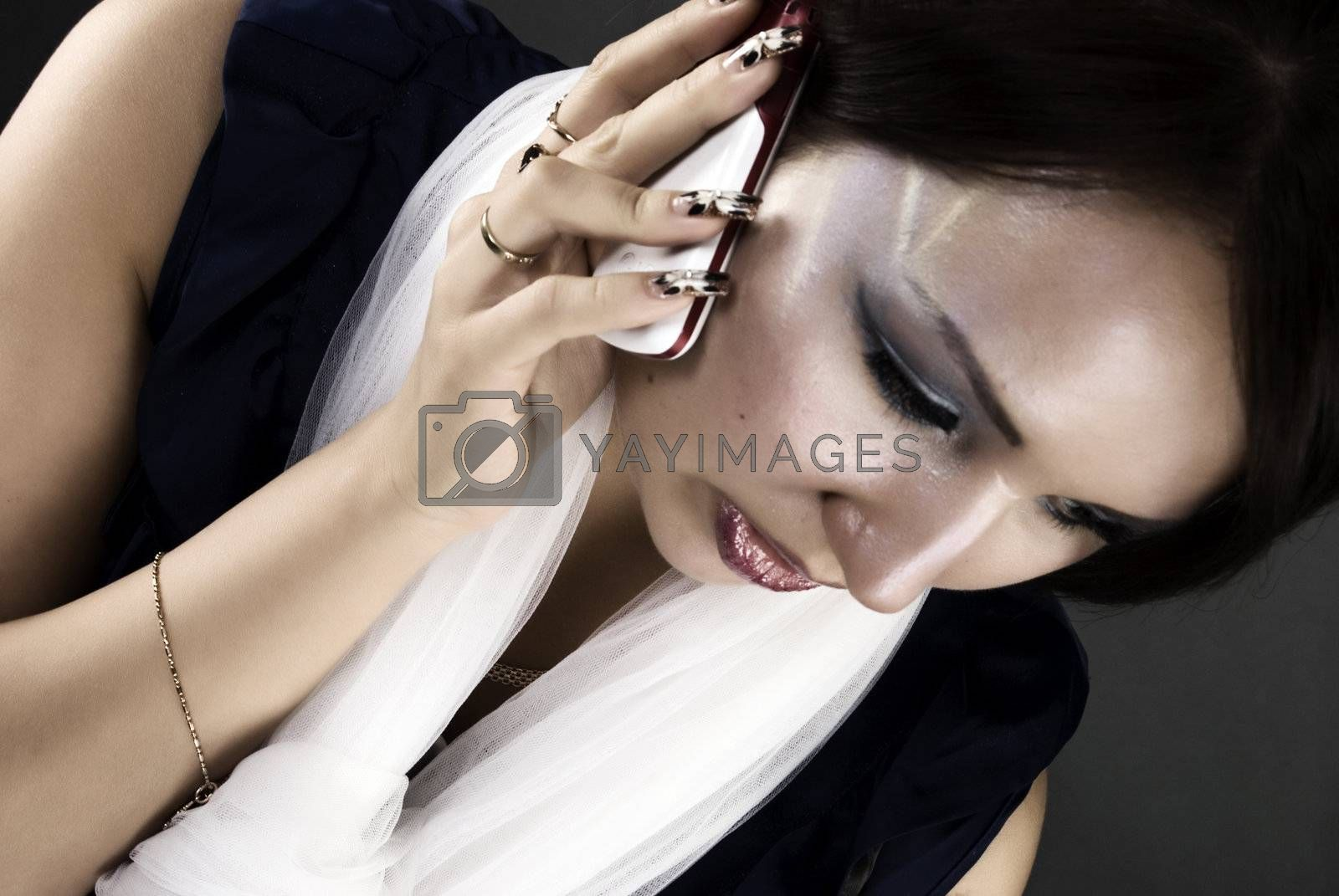 young beautiful brunette talking on the phone - communication