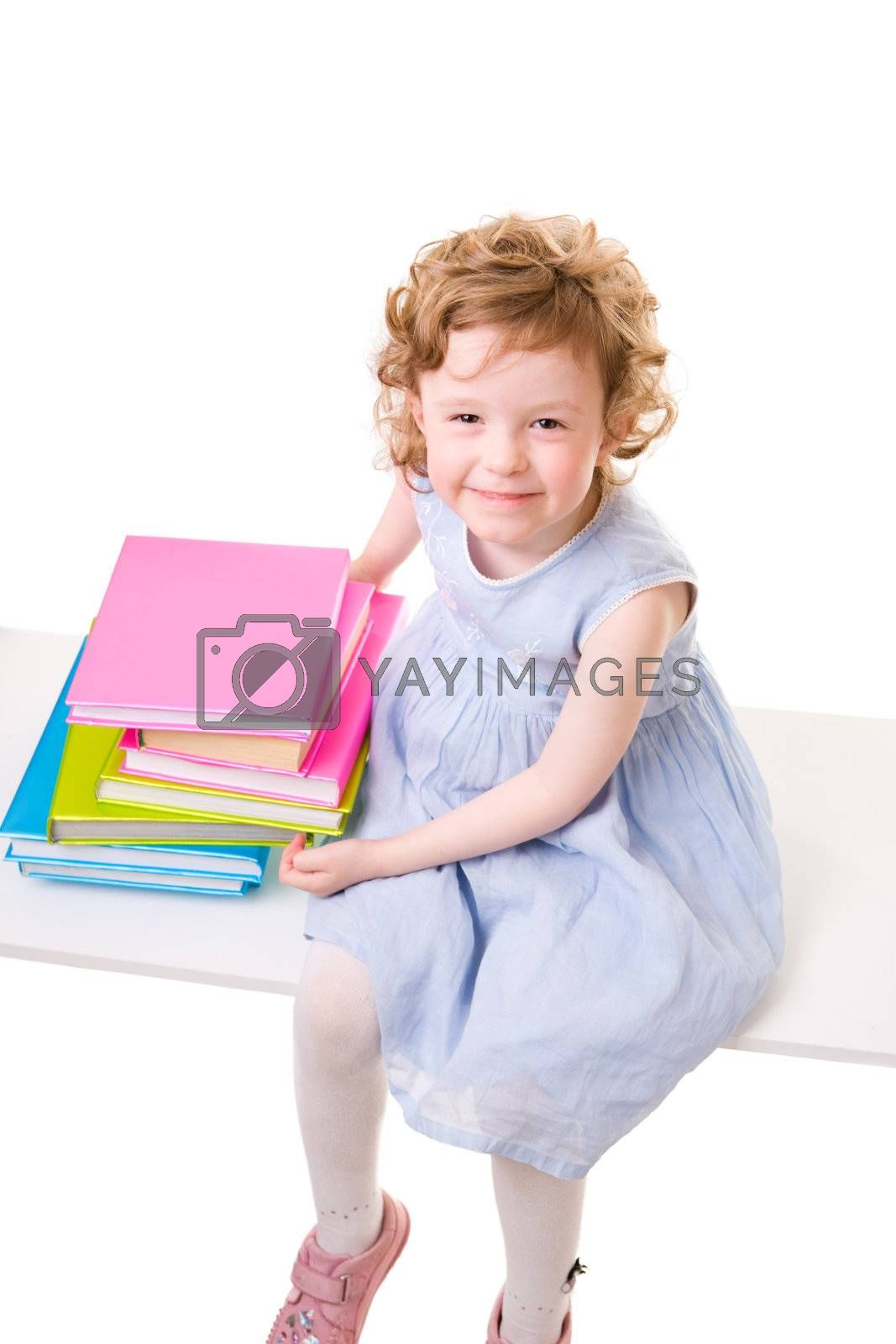 Back To School. Little girl with books isolated on white background