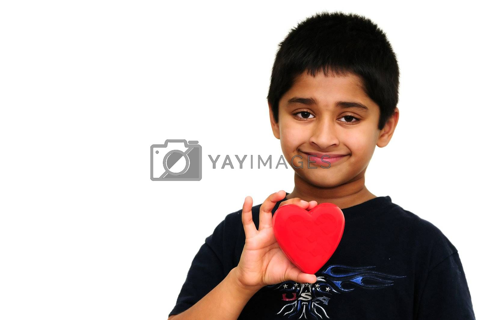Handsome young Indian boy holding a red heart