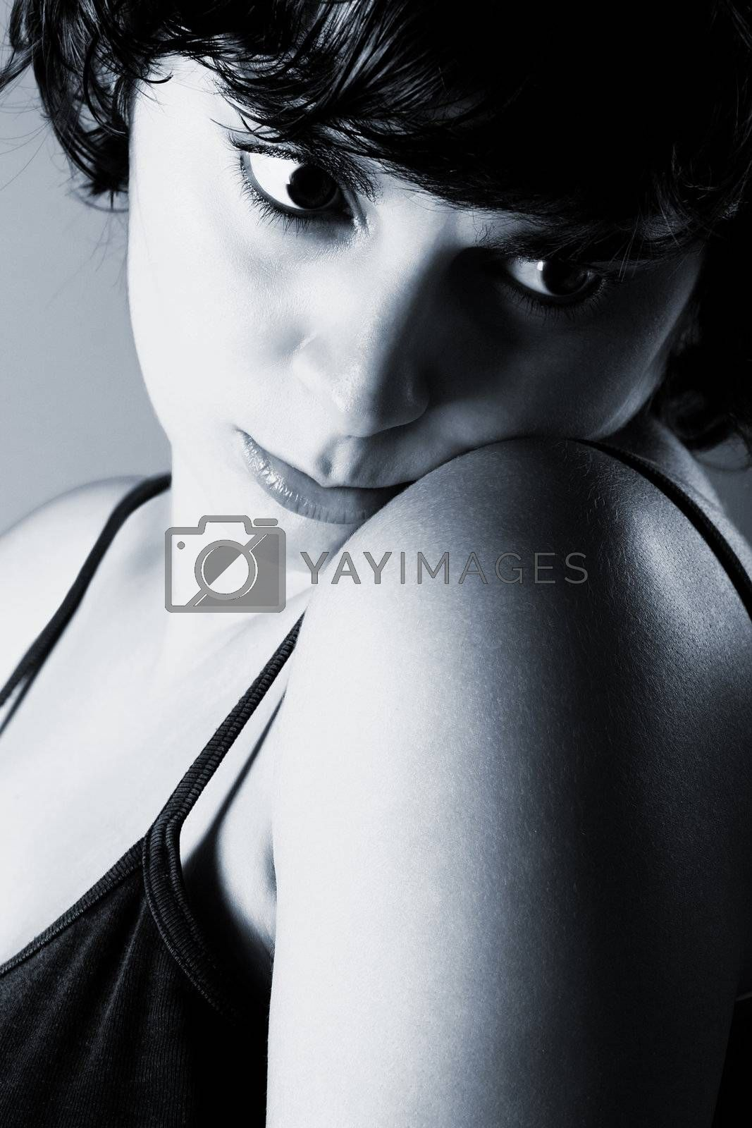 Close-up portrait of  a beautiful woman with a sad look