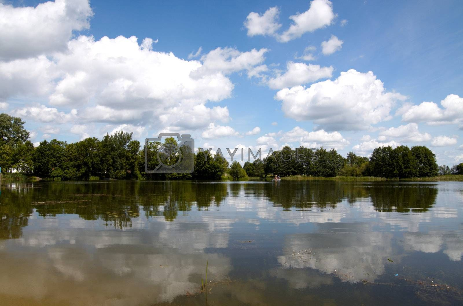 Summer landscape with a lake view, sky and clouds