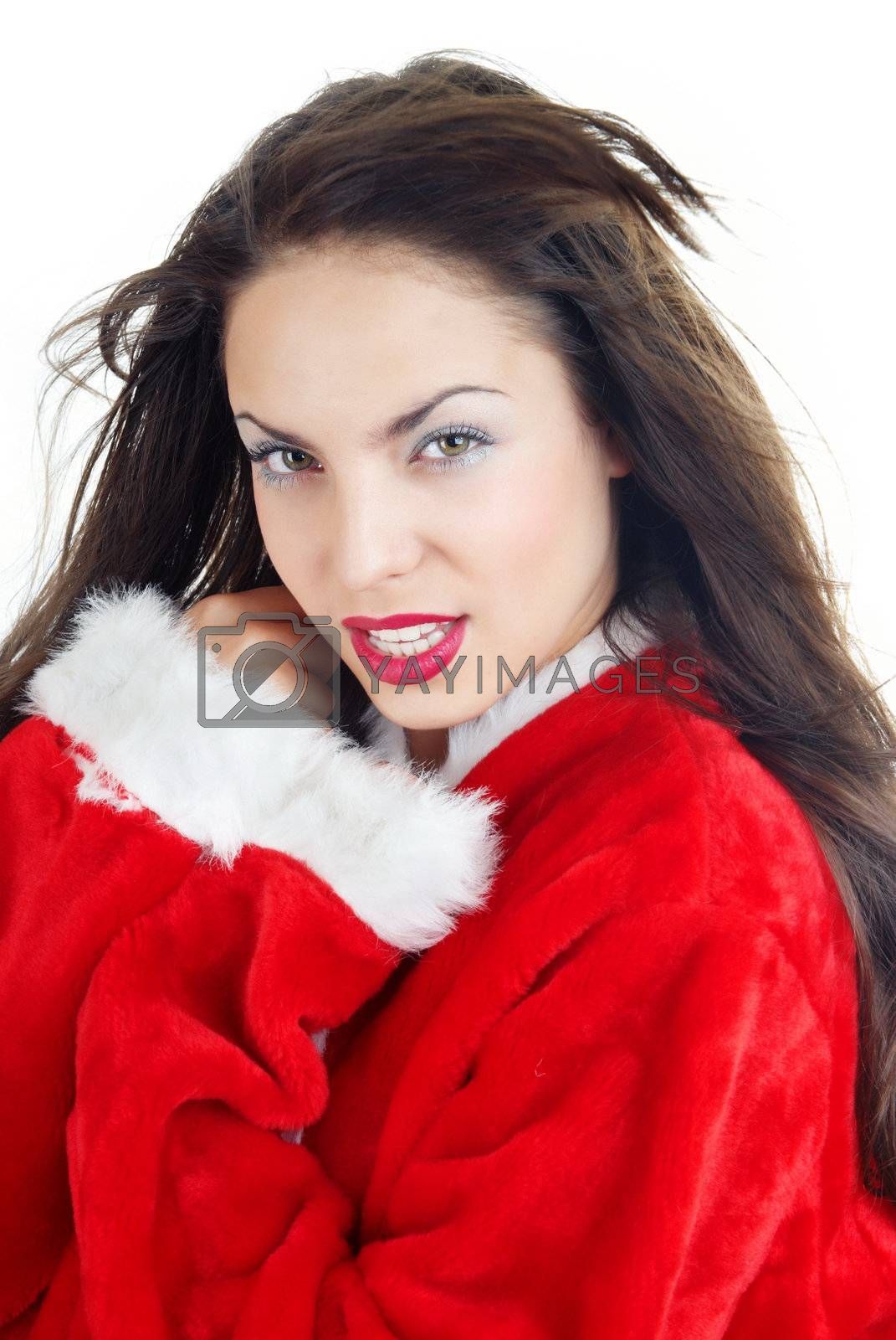 Attractive lady with blown hairs in the red furry Santa Claus costume on a white background