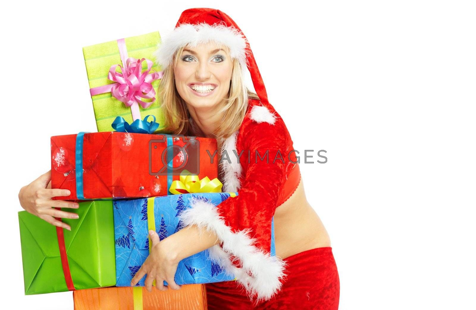 Smiling happy lady in the red Santa Claus costume holding gift boxes on a white background