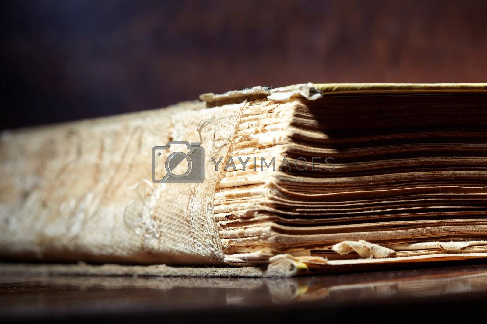 Damaged cover of the old book. Close-up photo with shallow depth of field for natural view