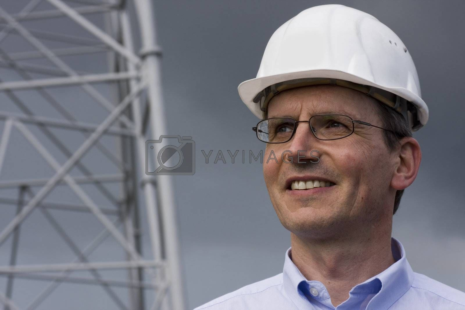 Smiling engineer with helmet on construction site