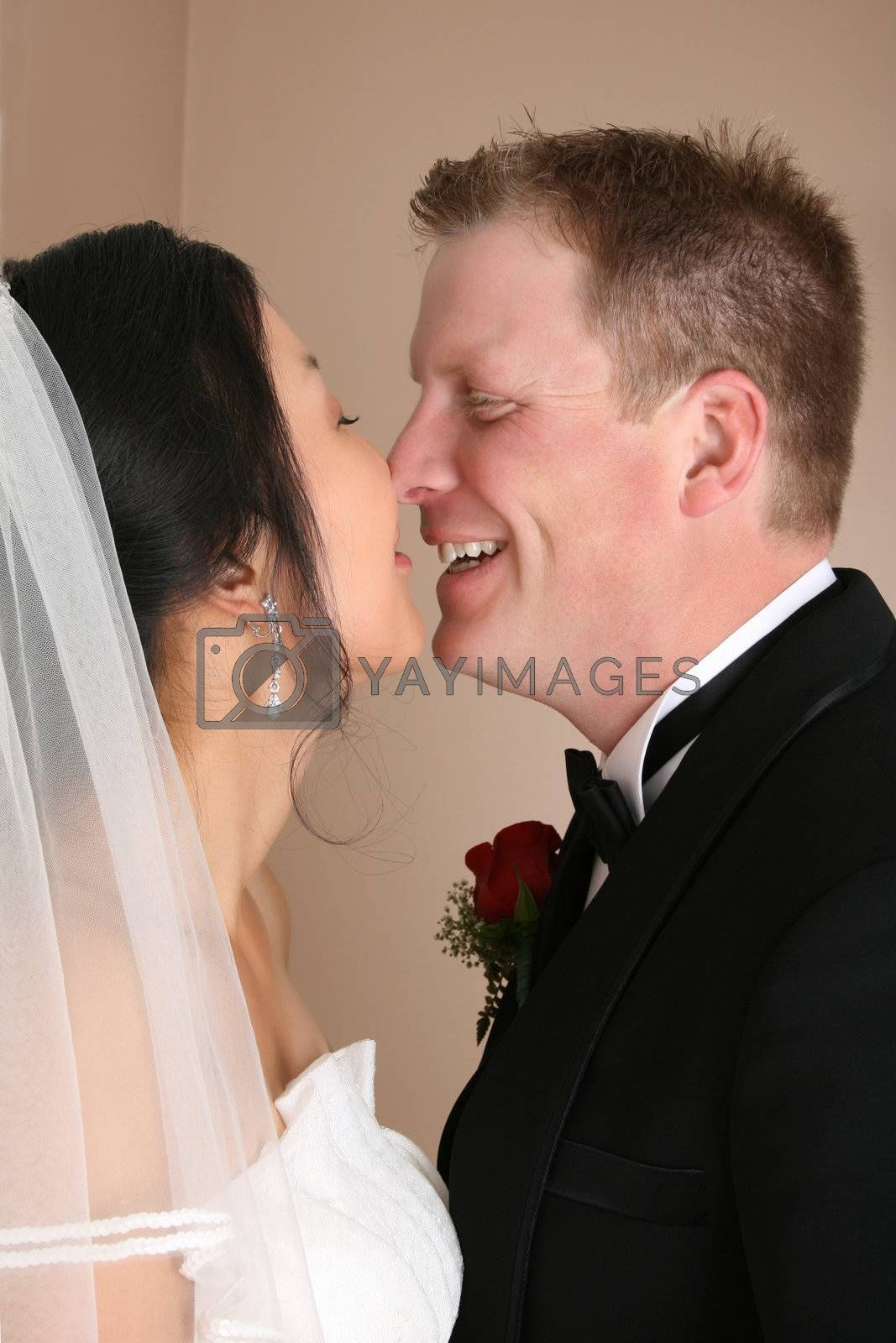 Bridal couple with their faces close together