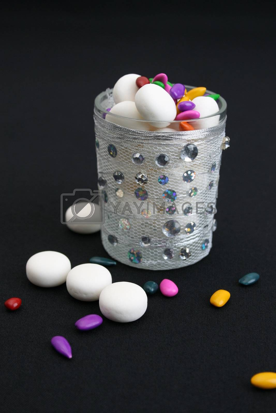 Decorated glass wih mints on a black background