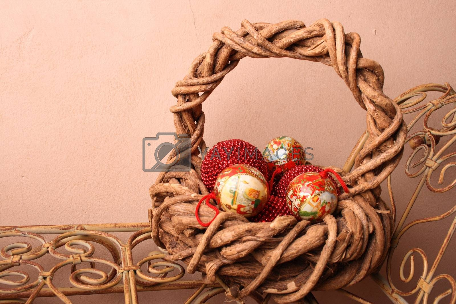 Woven Christmas basket on an old rustic bench