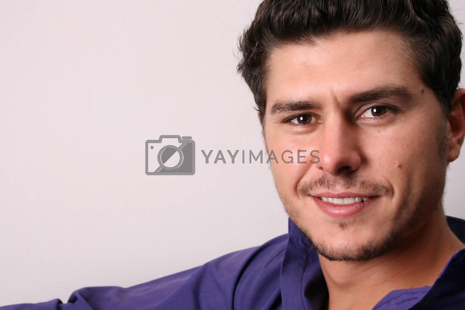 Male model in studio against white wall