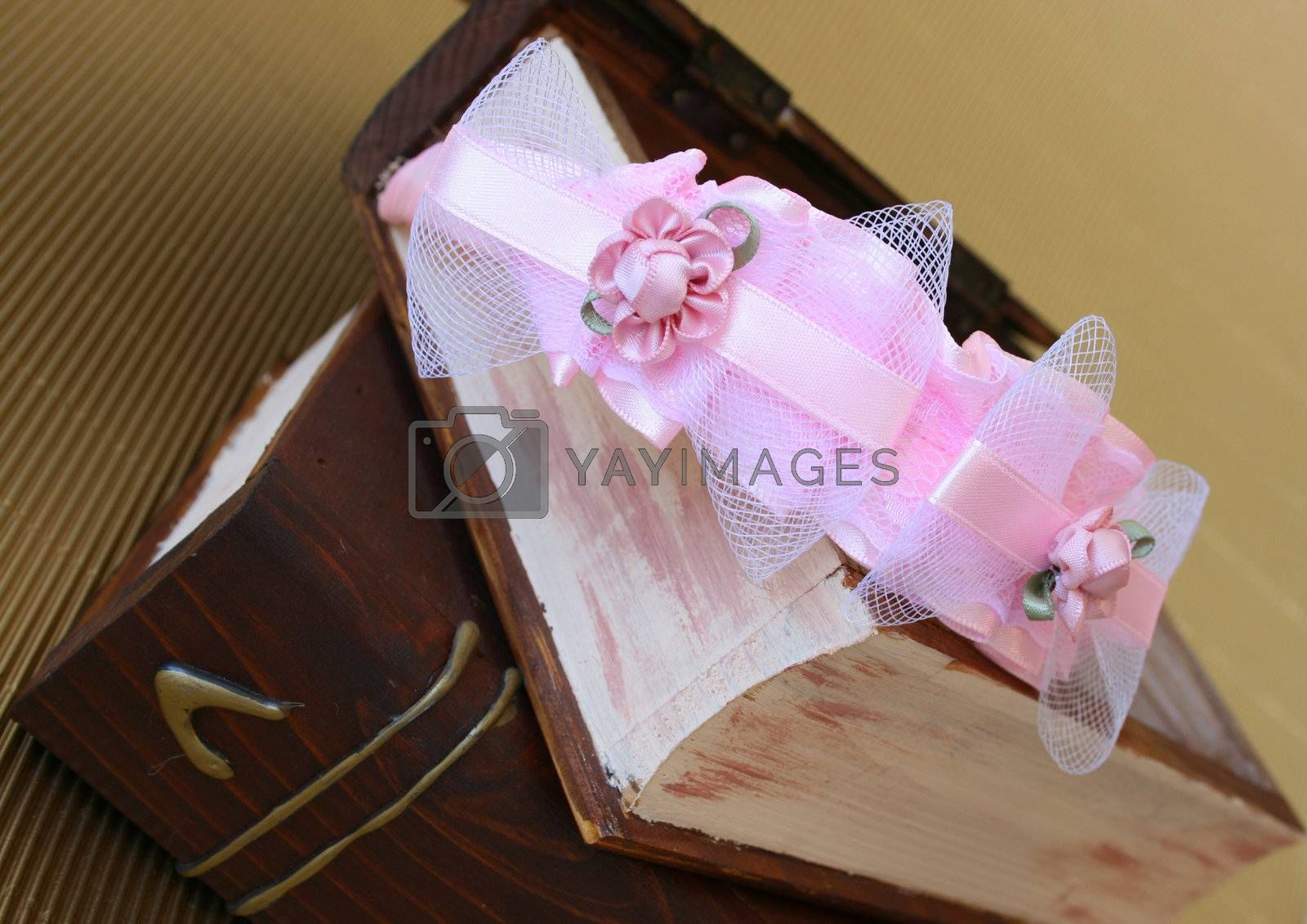 Pink Hair Accessories on a woonden jewellery box, on a golden background