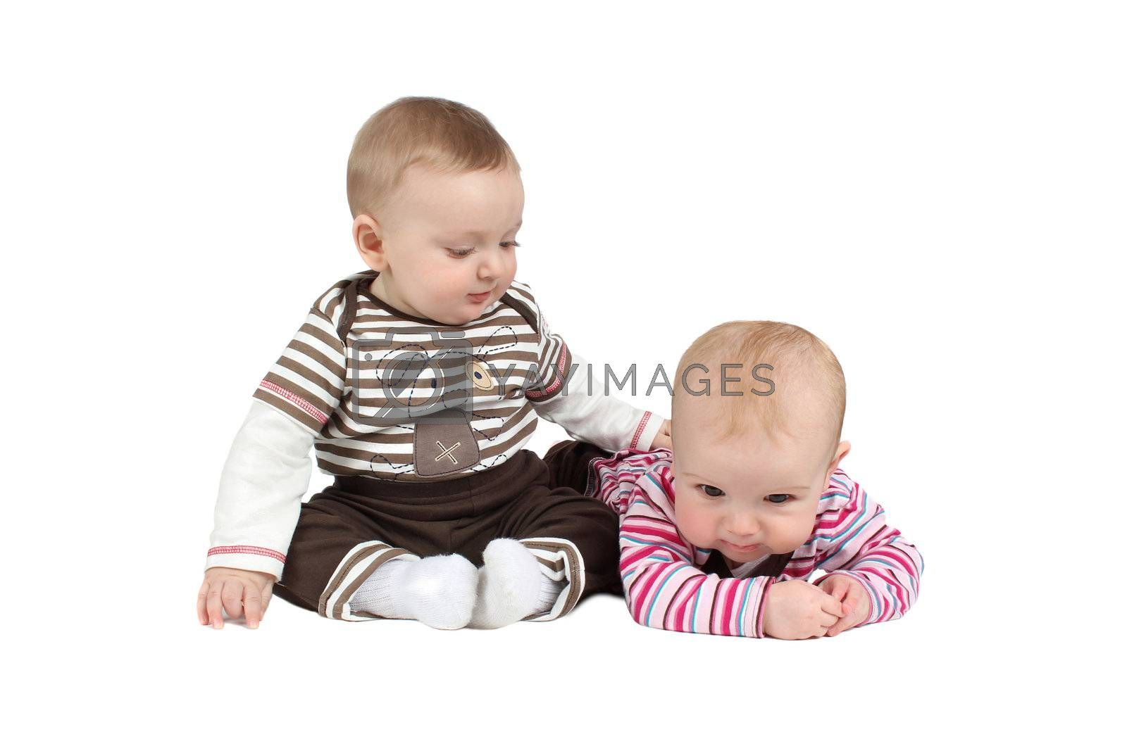 Baby boy and girl wearing striped clothing