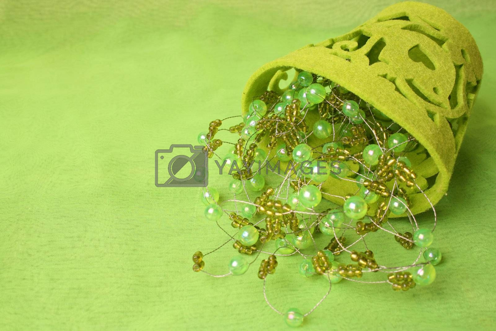 Green beads on wire in a soft container